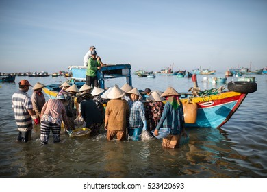 MUI NE, VIETNAM - November 9, 2016: Fishermen in the morning at the beach in Mui Ne on November 9, 2016, Vietnam.