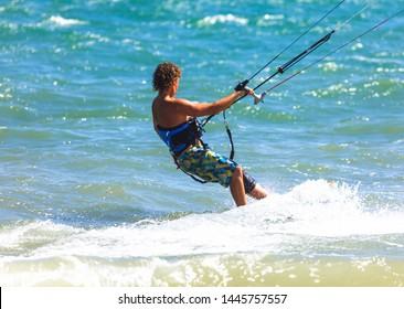 MUINE, VIETNAM - JANUARY 31, 2014: Athlete Kitesurfer or Kiteboarding photo Vietnam