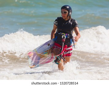 MUINE, VIETNAM - JANUARY 31, 2014: Girl athlete kiteboarding in Vietnam