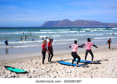 MUIZENBERG BEACH, CAPE TOWN, SOUTH AFRICA - 8 March 2018 : Muizenberg beach in Cape Town is a popular destination for early morning surfers.