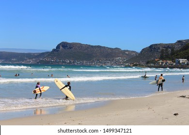 Muizenberg Beach, South Africa: Unidentified surfers enjoy waves at Muizenberg, a suburb of Cape Town (False Bay, Cape Peninsula), South Africa. The main surfing spot in Cape Town (Surfer's Corner).