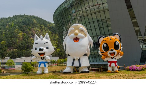 Muju,South Korea; May 1, 2019: Statues of Taekwondowon mascots, from left to right, Jin Jin, Baek Woon Dosa, and Tae Rang standing in front of competition arena.