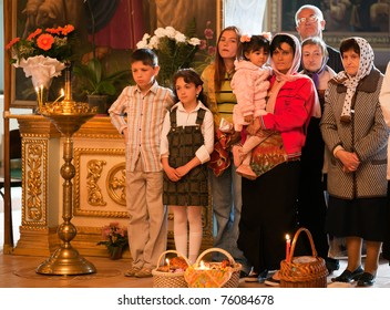 MUKACHEVO - APRIL 24: Easter Celebration in the Orthodox Church Cathedral of Our Lady of Pochayevskaya on April 23, 2011, Mukachevo, Ukraine. Unidentified child and family