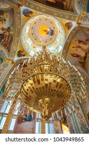 MUKACHEVO, UKRAINE AUGUST 31, 2013: golden chandelier with candles in the Orthodox Church. Krasnogorsky Monastery in honor of All Saints MUKACHEVO AUGUST 31, 2013 UKRAINE