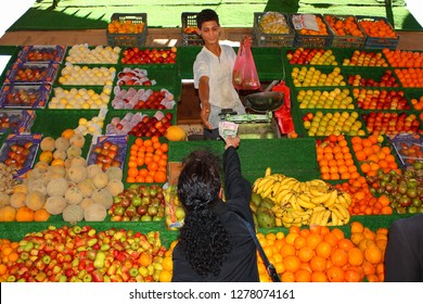 MUKALLA, YEMEN, DECEMBER 2008: unidentified man selling fruits on December 26, 2008 in Mukalla,  the capital of the Hadhramaut governorate in Yemen
