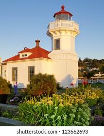Mukilteo white lighthouse building during sunset. Washington State.