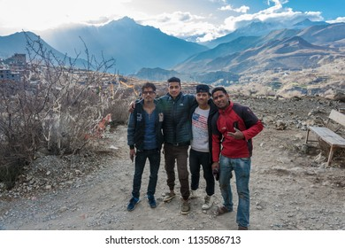 Muktinath, Nepal-07.04.2018: Four young nepalica against a mountain landscape 7 April 2018 in the vicinity of the city Muktinath, Nepal.