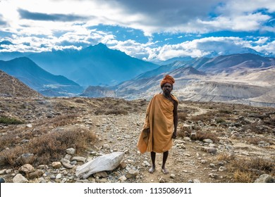 Muktinath, Nepal-07.04.2018: Sadhu on the background of a mountainous landscape on 7 April 2018 in the vicinity of the city Muktinath, Nepal.