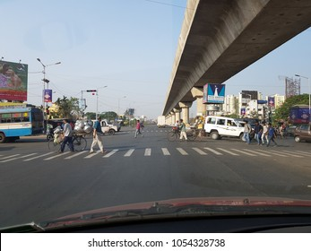 Mukundapur, west bengal, India, 21.3.2018, person crossing the road long zebra crossing under metro railway flyover which is under construction, Kolkata, India