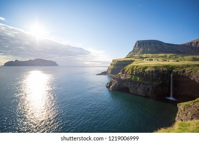 Mulafossur Waterfall with the village Gasadalur on the Faroe Islands.