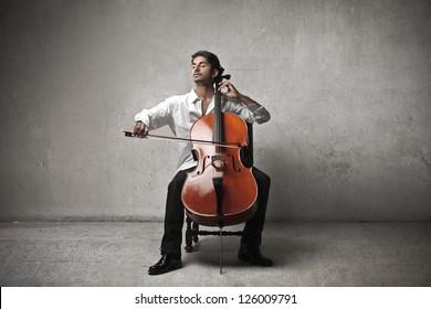 Mulatto man playing a cello