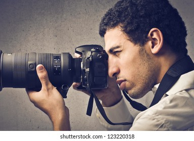 Mulatto man using a professional camera