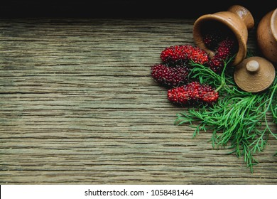 Mulberry fruit on a wooden background.Top view with copy space.