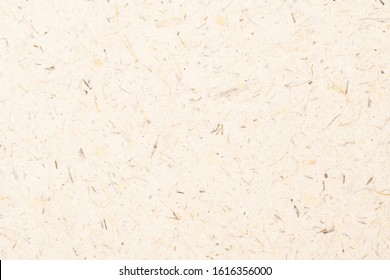 Mulberry paper with dry flower, fiber from banana tree and leaf texture background. Recycle paper, craft hand made paper, natural and eco-friendly material.