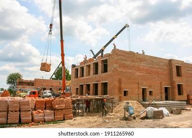 Mulchyci, Ukraine - June 22 2011: Construction of the building of brick.