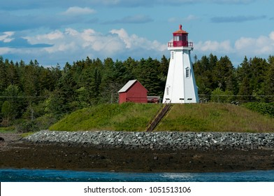 Mulholland lighthouse stands on hilltop during low tide on Campobello Island on the Canadian border.