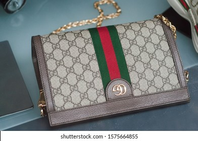 Mulhouse - France - 1 December 2019 - Closeup of beige leather handbag with famous pattern by Gucci in a luxury fashion store showroom
