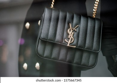 Mulhouse - France - 1 December 2019 - Closeup of Black leather handbag by Yves Saint Laurent in a luxury fashion Store showroom