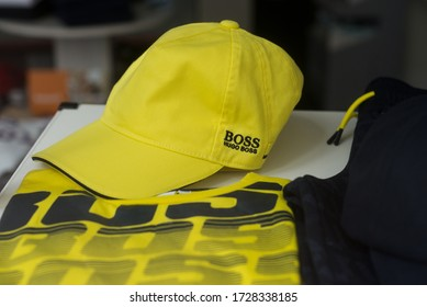 Mulhouse - France - 10 May 2020 - Closeup of yellow baseball cap by Hugo Boss in a luxury fashion store showroom