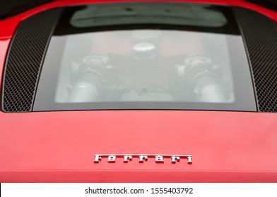 Mulhouse - France - 10 November 2019 - Rear view of Ferrari logo and V8 engine on red Ferrari 360 modena sport car parked in the street