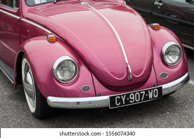 Mulhouse - France - 10 November 2019 - Front view of pink Volkswagen beetle parked in the street