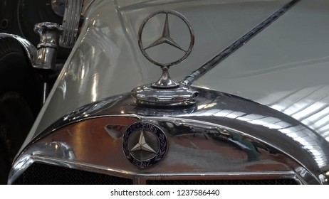 Mulhouse / France -11 21 2018: Mercedes Benz logo on old vintage veteran Mercedes Cabriolet Type 380 in Automobile Museum in Alsace region, the largest car collection in the world