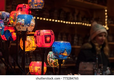 Mulhouse - France - 11 December 2017 - closeup of traditional candles at christmas market with blurred woman on background