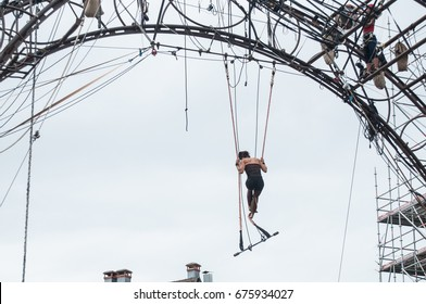 MULHOUSE - France - 11 July 2017 - Portrait of a young woman training on trapeze for an outdoor aerobatics show in the main place of Mulhouse