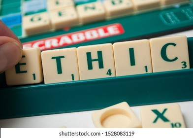 Mulhouse - France - 11 October 2019 - Closeup of plastic letters on Scrabble board game forming the word : Ethic