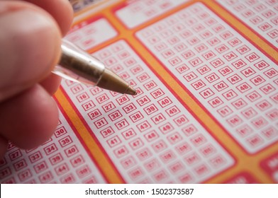 Mulhouse - France - 11 September 2019 - Closeup of man choice a number with a pen on french grids of Keno lotto from the society la francaise des jeux