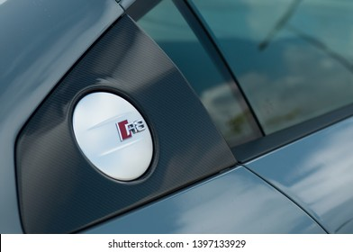 Mulhouse - France - 12 May 2019 - closeup of R8 logo on tank door on grey Audi R8 parked in the street