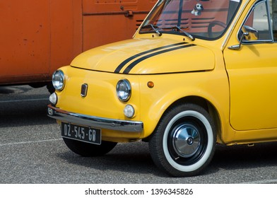 Mulhouse - France - 13 May 2019 -  old yellow Fiat 500 parked in the street