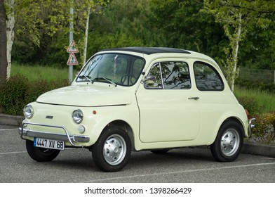 Mulhouse - France - 13 May 2019 -  old green Fiat 500 parked in the street