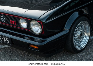 Mulhouse - France - 13 October 2019 - Closeup of black Volkswagen Golf GTI fort generation parked in the street