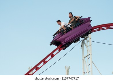 Mulhouse - France - 15 August 2018 - roller coaster with shouting people in attraction park in Mulhouse