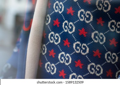 Mulhouse - France - 15 December 2019 - Closeup of Gucci logo on blue pullover in luxury fashion store showroom