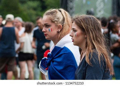 Mulhouse - France - 15 July 2018 - french supporter of football with french flag painting on face during the giant screen projection of the final of the world cup france - croatia