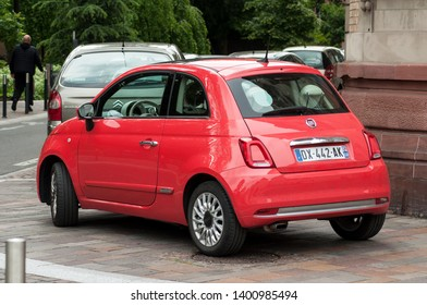 Mulhouse - France - 18 August 2018 - fiat 500 coral color parked in the street