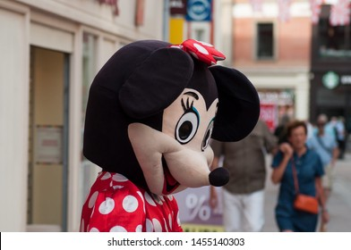 Mulhouse - France - 18 July 2019 - people with Minnie mouse costume in the street