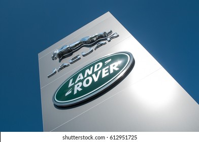 """MULHOUSE - France - 1st  April 2017 -  retail of the logo of the brand """"Jaguar """" and """"Rover"""" the british brand of cars signage on showroom"""