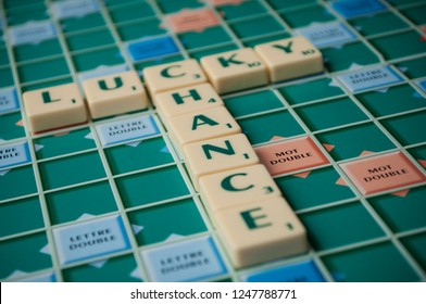 Mulhouse - France - 2 December 2018 - Closeup of plastic letters with words lucky and chance on Scrabble board game