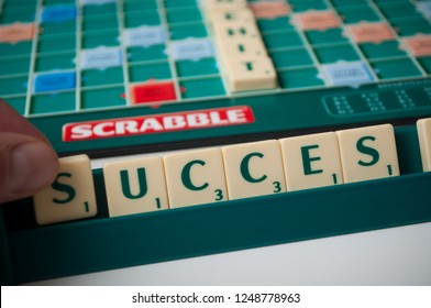 Mulhouse - France - 2 December 2018 - Closeup of plastic letters with word success  on Scrabble board game