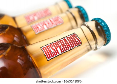 Mulhouse - France - 2 March 2020 - Closeup of Desperados bier lemon bottles on white background, desperados is the famous brand of mexican bier with tequila