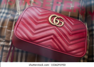 Mulhouse - France - 20 October 2019 - Closeup of red leather from Gucci brand in a luxury fashion store showroom