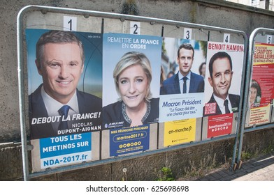 MULHOUSE - France -21 April 2017:  official campaign posters of political party leaders ones of the eleven candidates running in the 2017 French presidential election