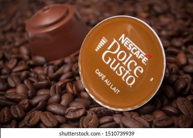 Mulhouse - France - 21 September 2019 - Closeup of a Dolce gusto nescafe expresso coffee capsules on coffee beans background