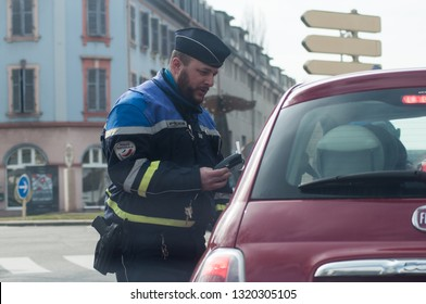 Mulhouse - France - 22 Fevrier 2019 - portrait of policeman controlling alcohol on drivers in the street