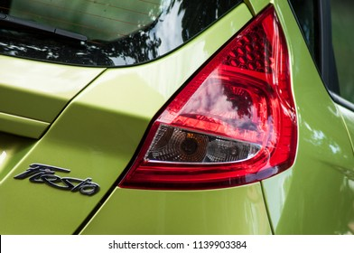 Mulhouse - France - 22 July 2018 - closeup of rear light and logo of green ford fiesta