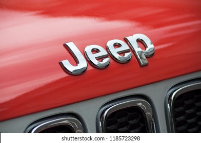 Mulhouse - France - 22 September 2018 - closeup of jeep logo in orange front car parked in the street