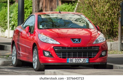 Mulhouse - France - 24 Aprill 2018 - Red Peugeot 308 CC parked in the street
